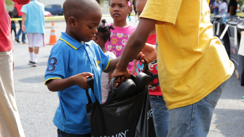 BOBS from SKECHERS distributes new shoes to children in need in Atlanta, Georgia. (Image courtesy of Caring for Others and Carlos Bell Photography)