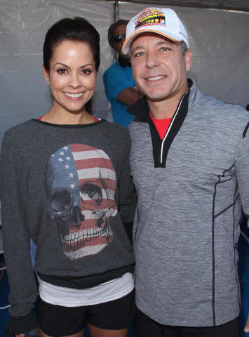 Brooke Burke-Charvet and SKECHERS president Michael Greenberg at the fourth annual SKECHERS Pier to Pier Friendship Walk. (Photo: Business Wire)