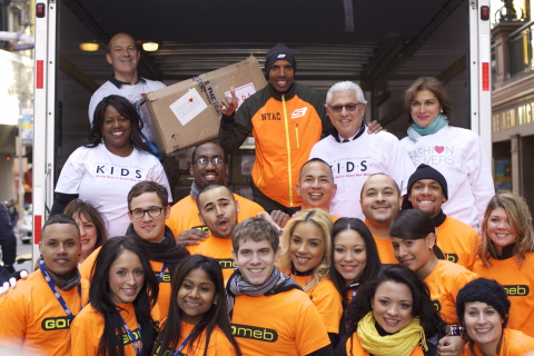 Meb joins SKECHERS employees in Times Square to load shoes that will be distributed through disaster relief organizations in New York and New Jersey. (Photo: Business Wire)
