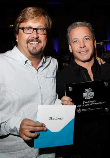 Shade Hotel owner Michael Zislis presents the 2014 Best of Manhattan award to Skechers president Michael Greenberg.
