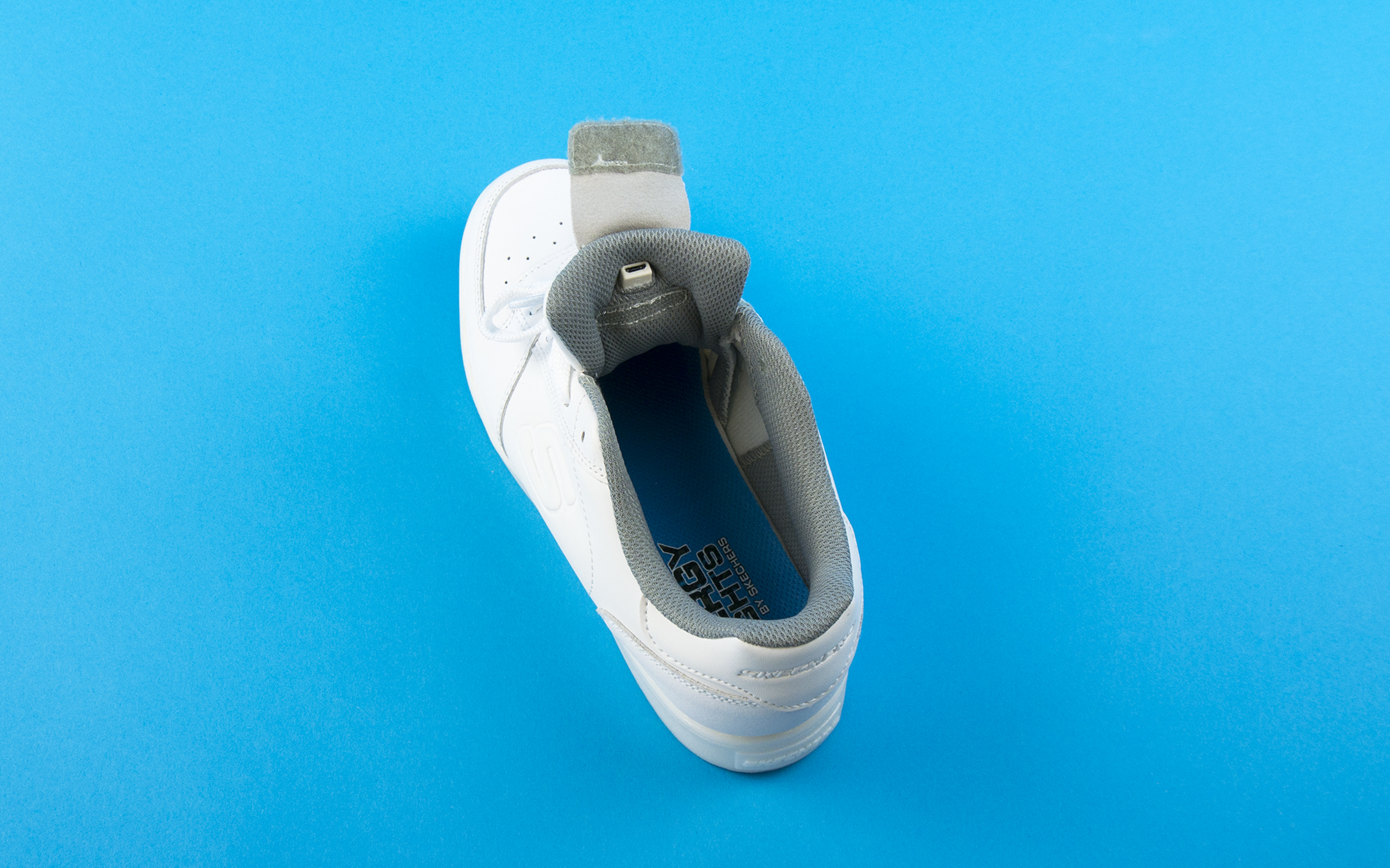 d078c9d3c703 INSERT CABLES – Energy Lights have a dual cable so you can charge both  shoes simultaneously. Just insert the cables into the ports on each shoe  (make sure ...